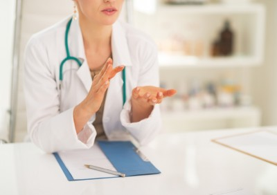 Closeup on medical doctor woman explaining something